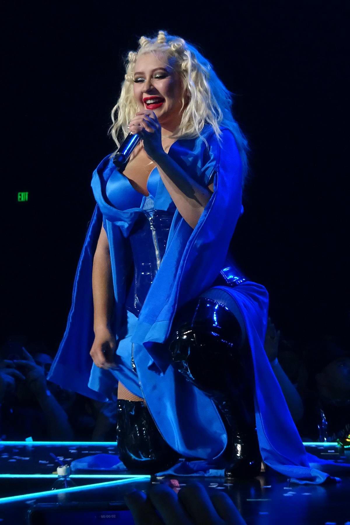 Christina Aguilera performs at the Grand Opening of 'Christina Aguilera: The Xperience' at Planet Hollywood Resort & Casino in Las Vegas, Nevada