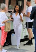 Christina Milian in all white seen smiling and working at her food truck 'Beignet Box' in Studio City, Los Angeles