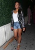 Christina Milian wore a sparkly jacket, white top and denim shorts during a night out at Delilah in West Hollywood, Los Angeles