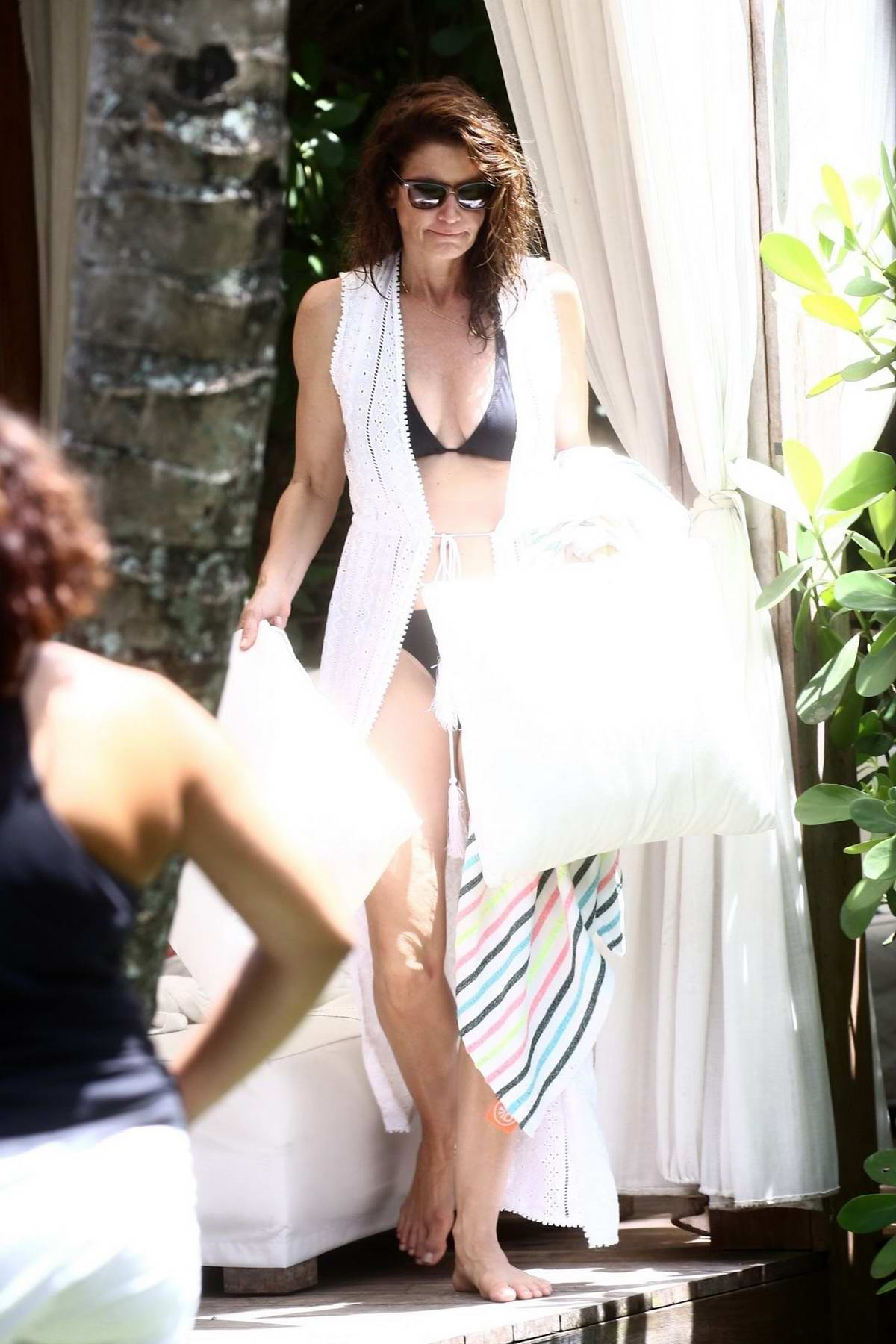 Cindy Crawford seen relaxing by the pool while on vacation in Miami, Florida