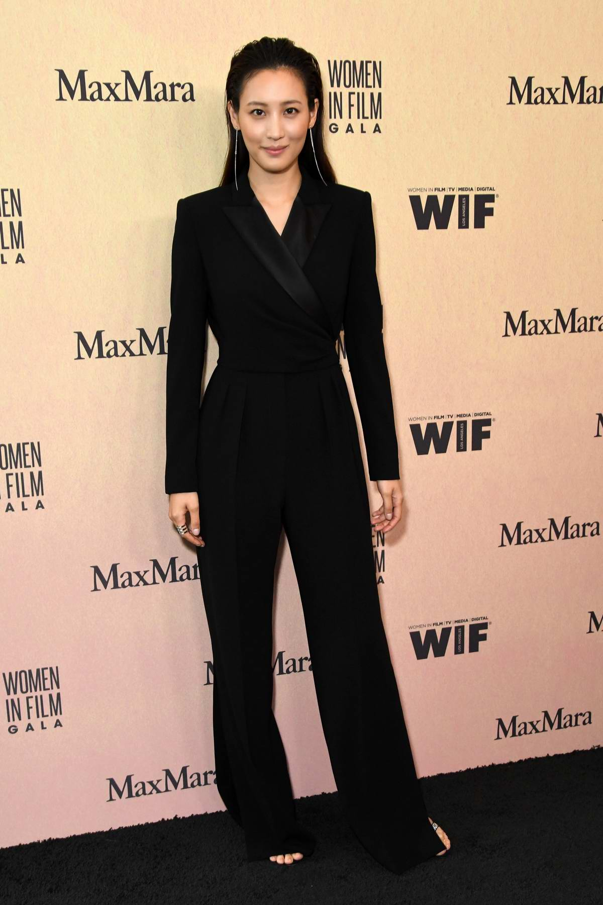 Claudia Kim attends the Women in Film Annual Gala presented by Max Mara at The Beverly Hilton Hotel in Los Angeles