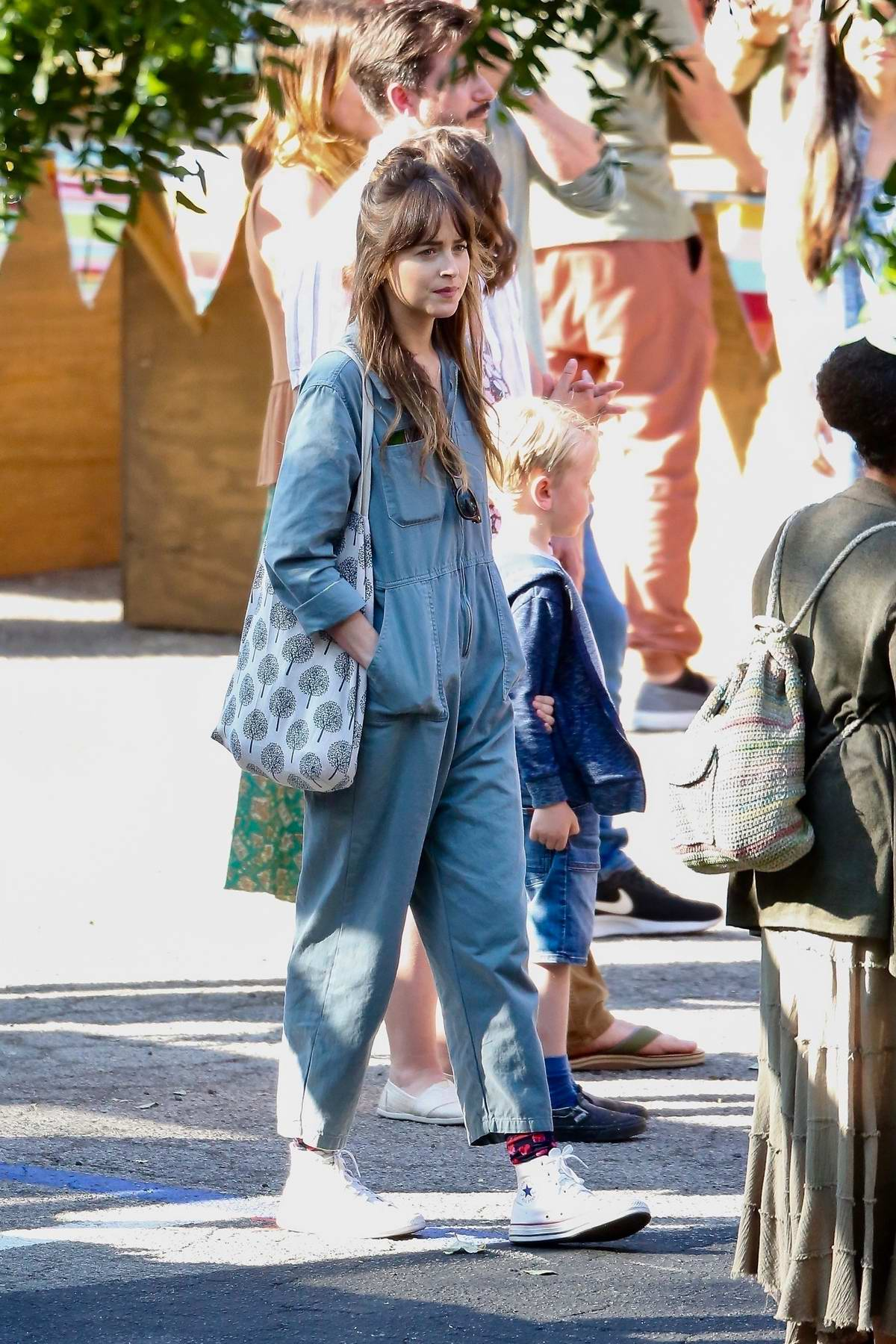 Dakota Johnson spotted filming for her upcoming movie 'Covers' in Los Angeles