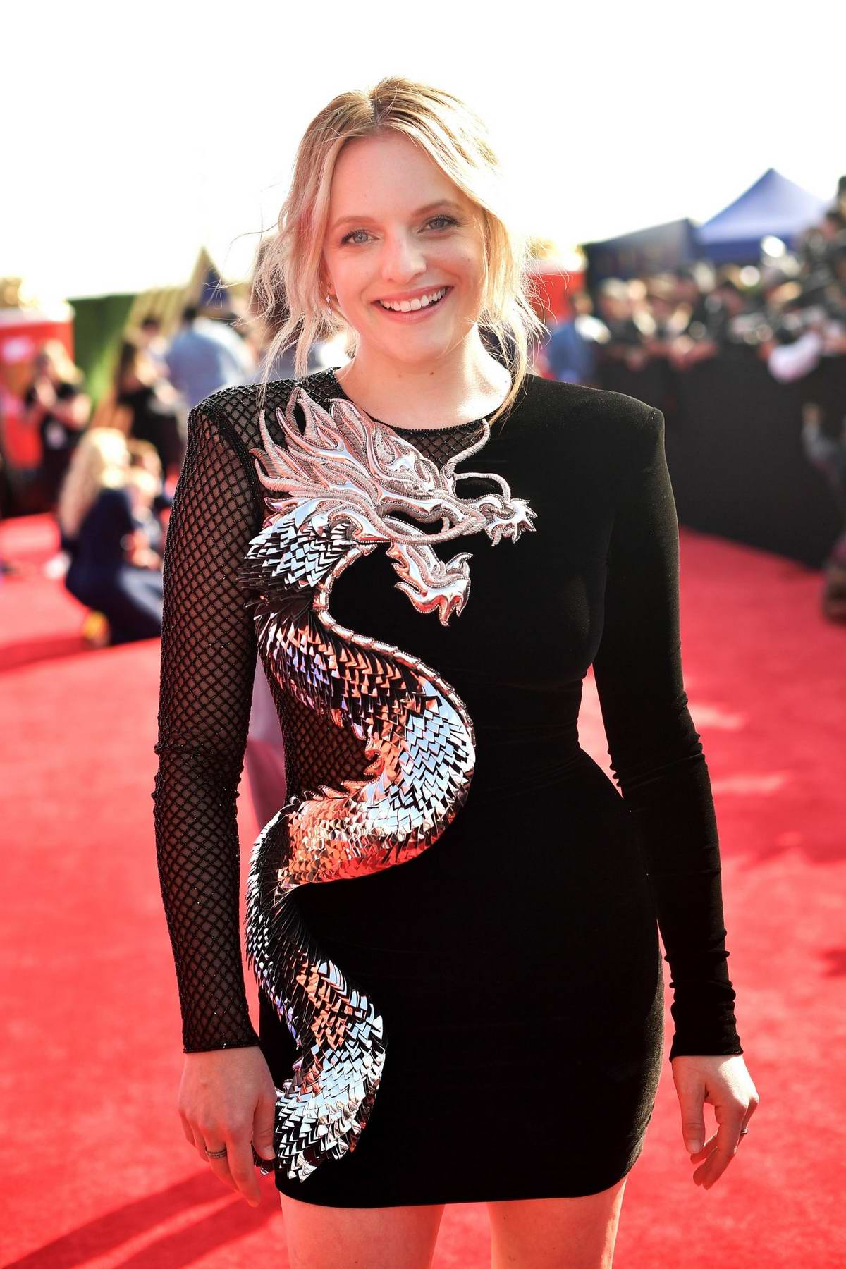 Elisabeth Moss attends the 2019 MTV Movie and TV Awards at Barker Hangar in Santa Monica, California