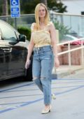 Elle Fanning looks lovely in a yellow floral top as she steps out for lunch in Los Angeles
