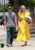 Elle Fanning seen wearing a bright yellow summer dress while out for some shopping with Max Minghella in Silver Lake, Los Angeles