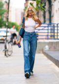 Elsa Hosk dons white tank top and blue flared jeans while out in New York City