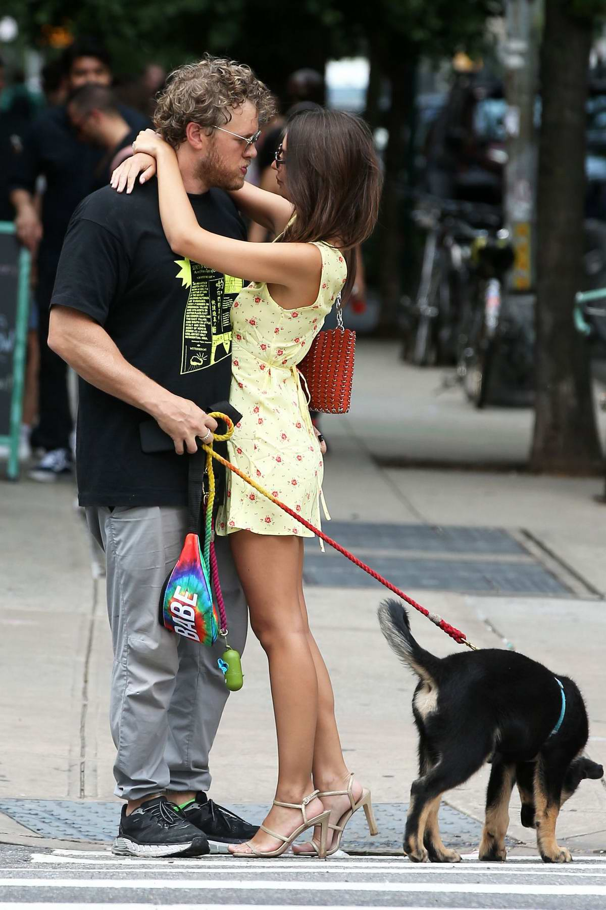 Emily Ratajkowski and Sebastian Bear-McClard share a kiss while out for a stroll with their dog in New York City