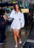 Emily Ratajkowski flaunts her legs in a short white dress while out in Soho, New York City