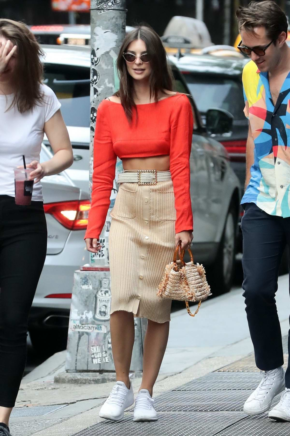 Emily Ratajkowski steps out for a stroll in a red crop top and beige skirt in New York City