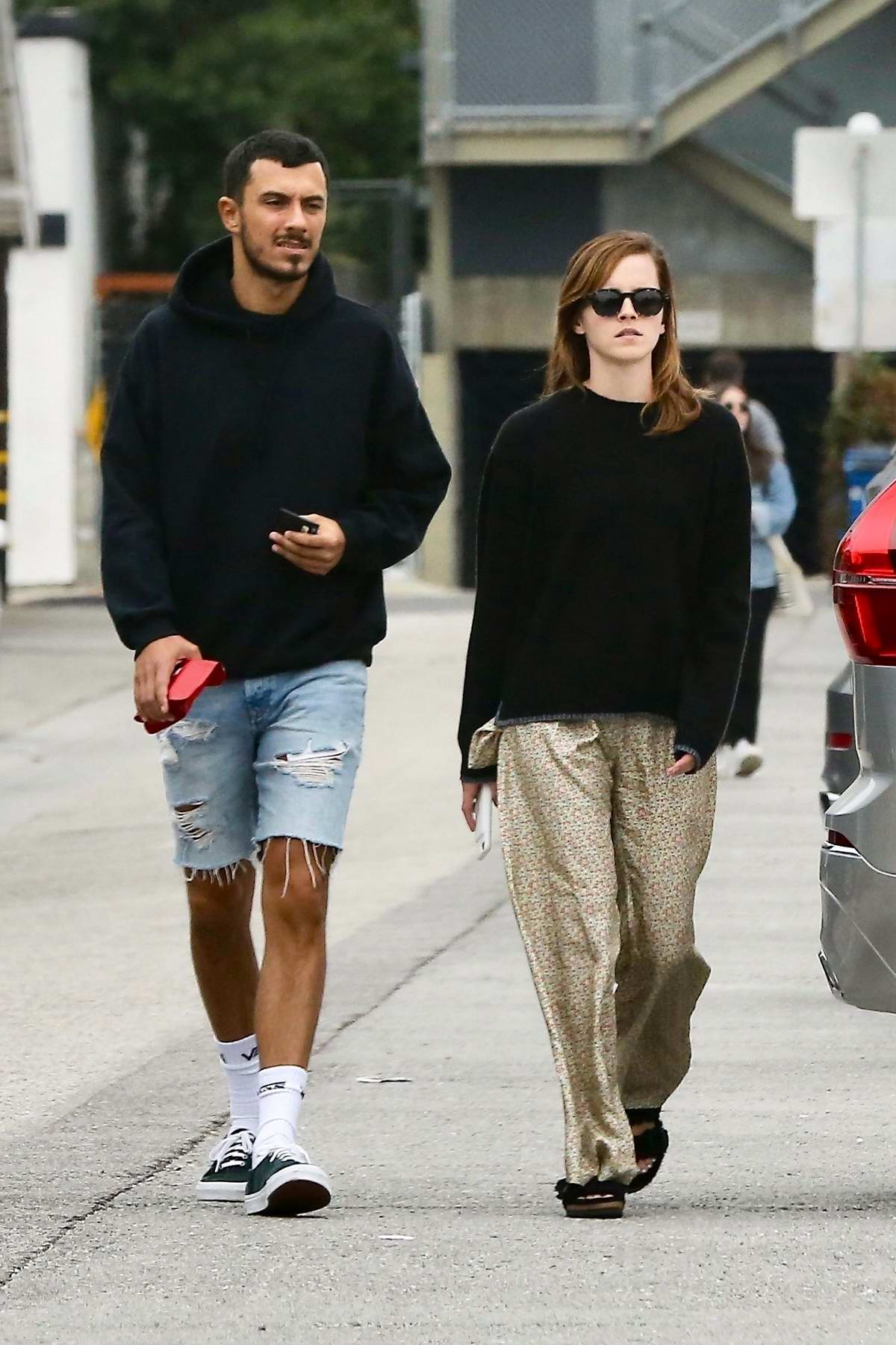 Emma Watson steps out for an afternoon walk with a male companion on Abbot Kinney Boulevard in Venice, California