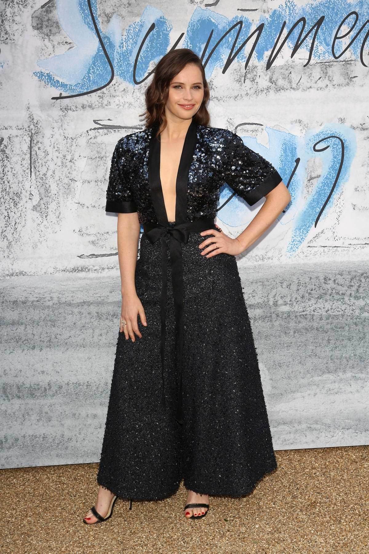 Felicity Jones attends The Summer Party 2019 at Serpentine Gallery at Kensington Gardens in London, UK