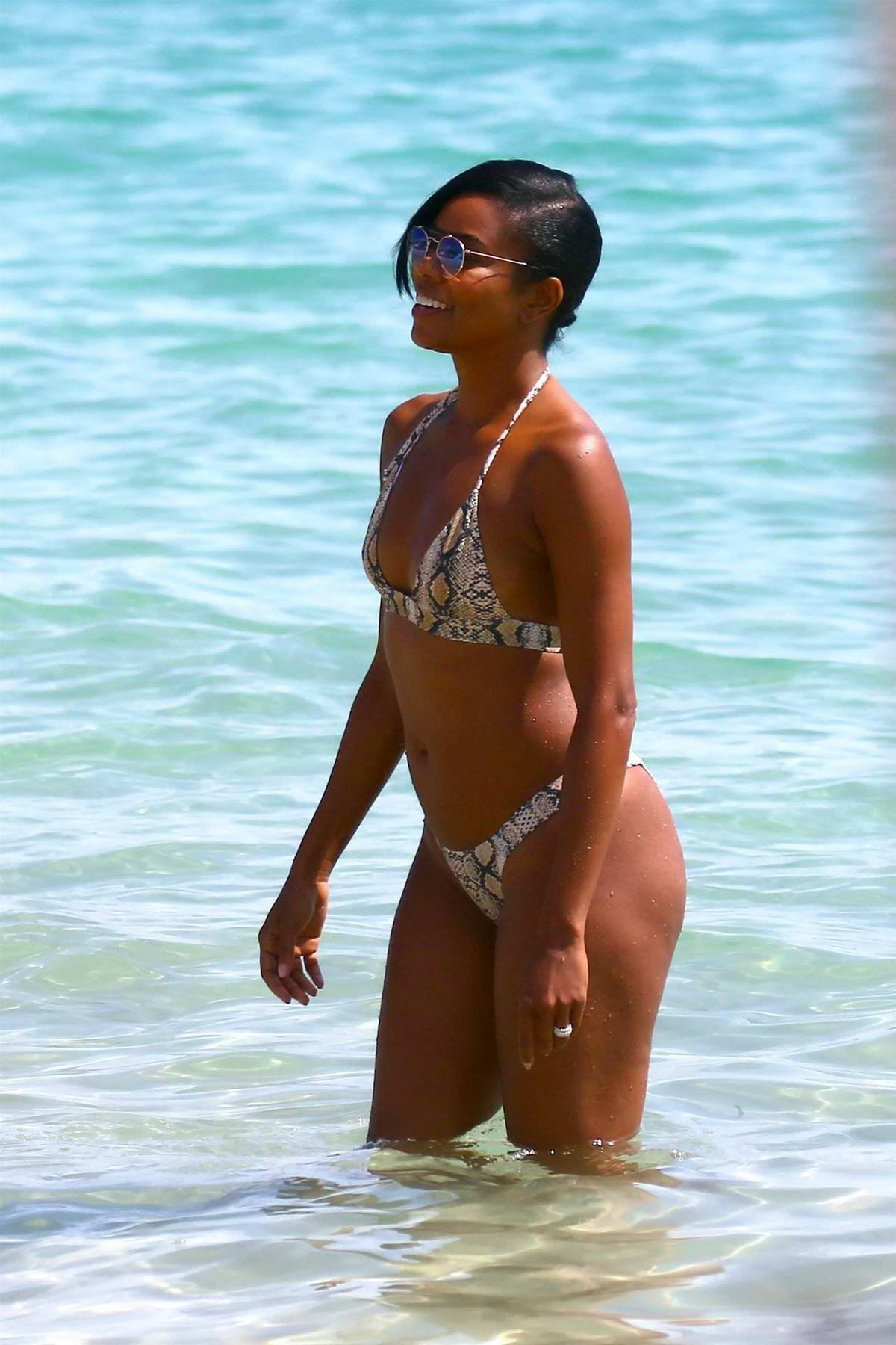 Gabrielle Union spotted in snakeskin print bikini while having fun on the beach in Cannes, France
