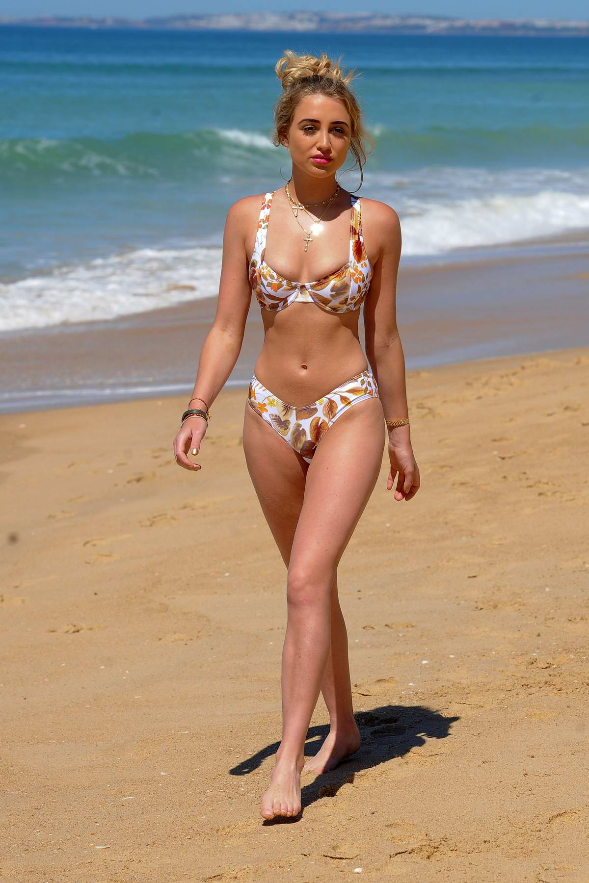 Georgia Harrison seen wearing floral print bikini while at the beach in Portugal