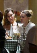 Gigi and Bella Hadid are spotted dining al fresco at a restaurant with friends in Florence, Italy