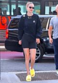 Gigi Hadid is all smiles as she arrives at an office building in Manhattan, New York City