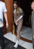 Gigi Hadid seen wearing a patterned jumpsuit and white trainers as she leaves her hotel in Florence, Italy