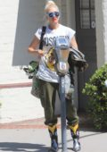 Gwen Stefani keeps it stylish in Moschino t-shirt and Chanel camouflage jacket while out in Beverly Hills, Los Angeles
