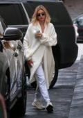 Hailey Baldwin keeps it cozy in a white long coat and sweatpants as she leaves a dermatologist office in Beverly Hills, Los Angeles