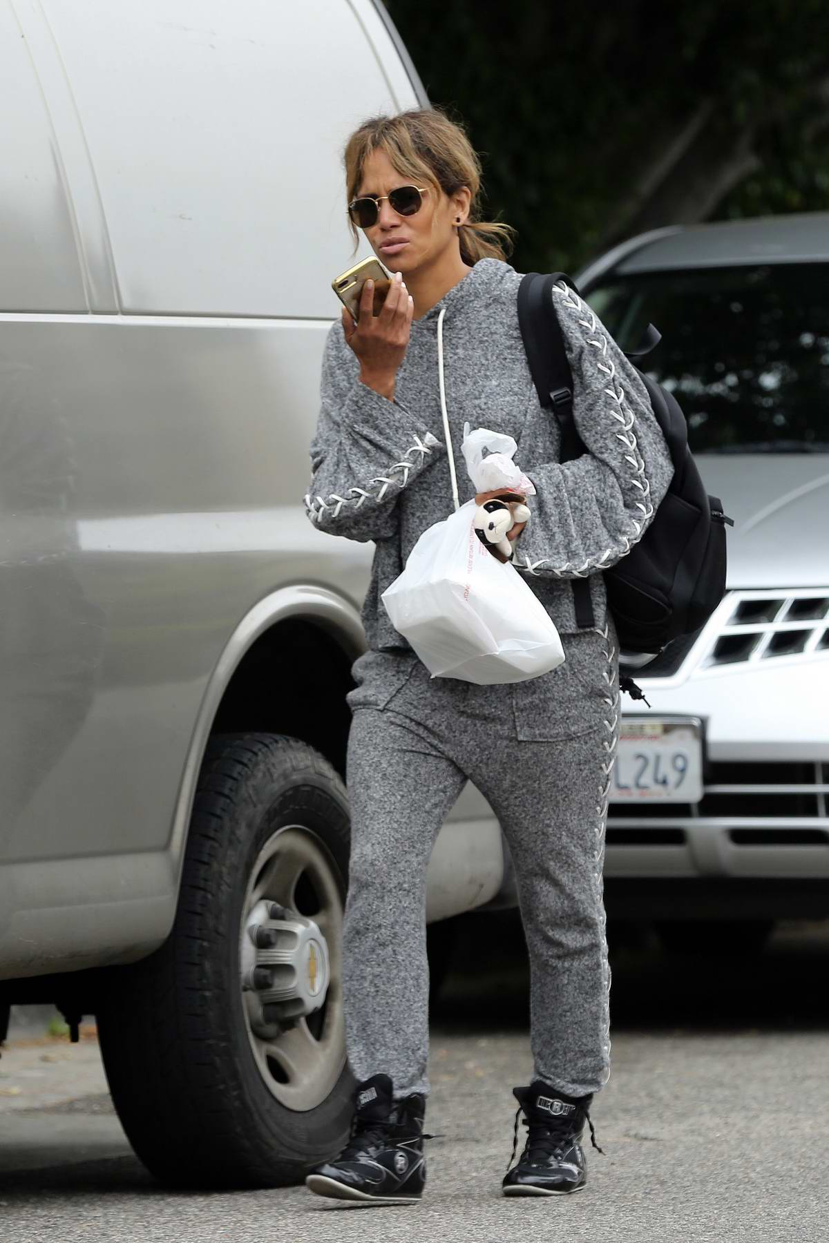 Halle Berry chats on her phone as she leaves the gym in Los Angeles