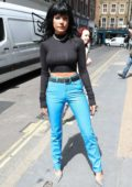 Halsey wears a black skin-tight top and electric blue trousers as she arrives at KISS FM studios in London, UK