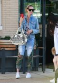 Heidi Klum keeps it trendy in double denim during a shopping trip to Barneys New York in Beverly Hills, Los Angeles