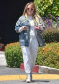Hilary Duff looks comfy in a grey sweatsuit and denim jacket during a coffee run in Studio City, Los Angeles