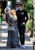 Hilary Duff looks lovely in a floral print dress as she steps out with Matthew Koma for a day of shopping in Los Angeles
