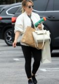 Hilary Duff wears a white jacket, black leggings and trainers as she makes a shopping trip to Beverly Hills, Los Angeles