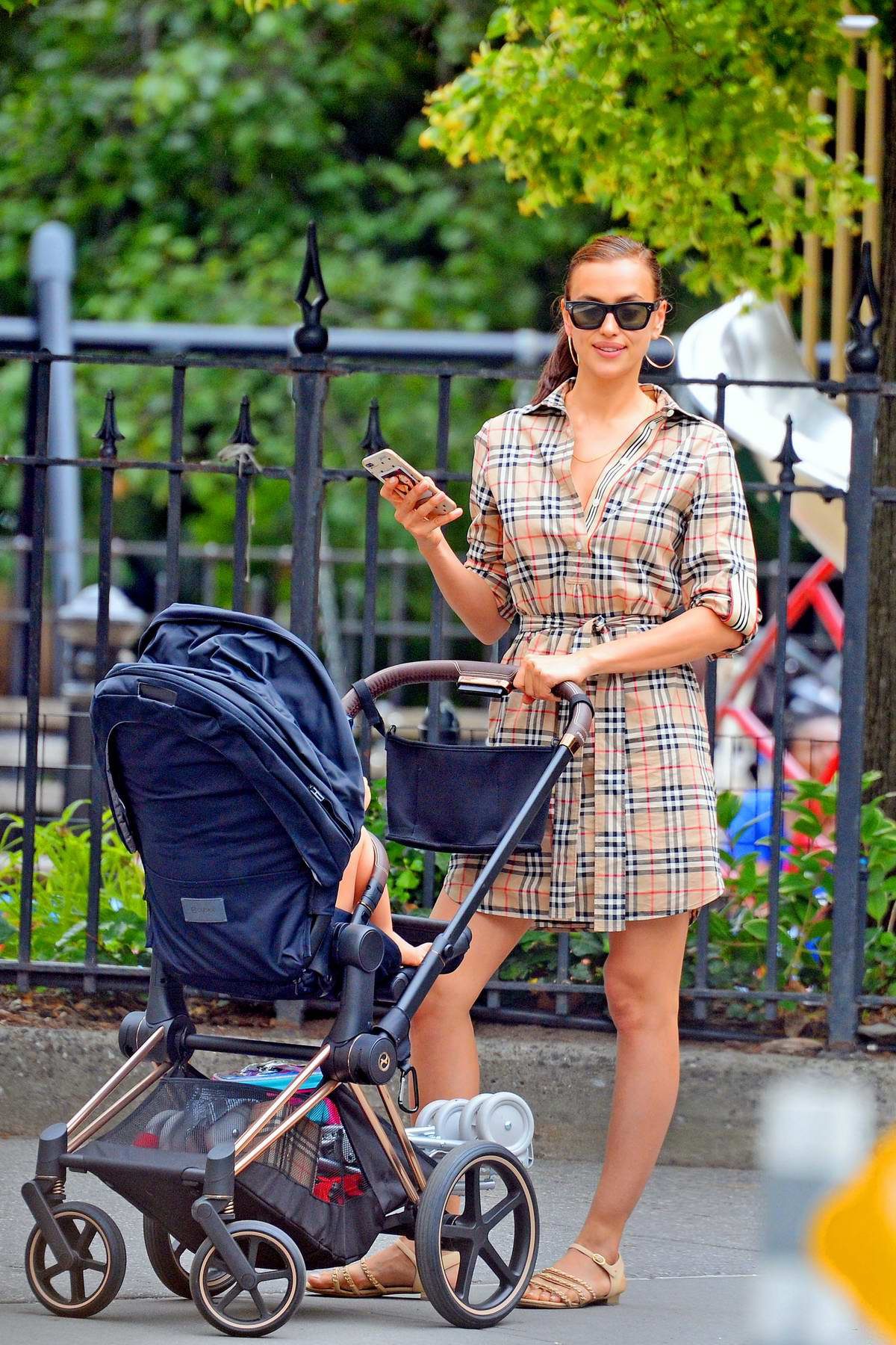 Irina Shayk dons plaid as she takes her daughter Lea for a stroll in New York City