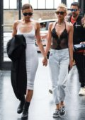 Irina Shayk looks stunning in a form-fitting white dress while stepping out with Stella Maxwell in Florence, Italy