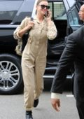 Irina Shayk rocks a khaki jumpsuit as she arrives for a flight out of LAX Airport in Los Angeles