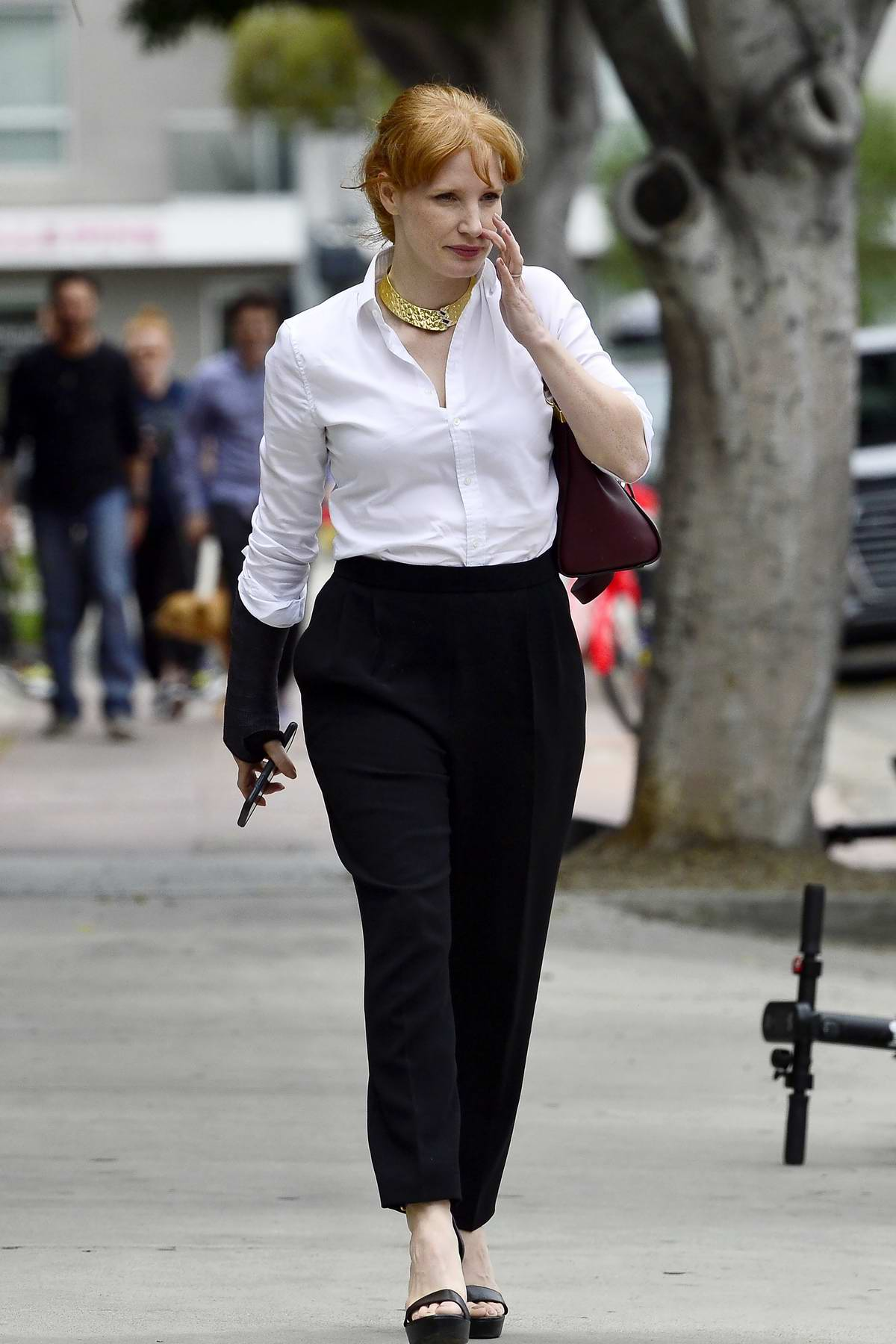 Jessica Chastain steps out in white shirt, black trousers and a wrist brace for a breakfast meeting in Los Angeles