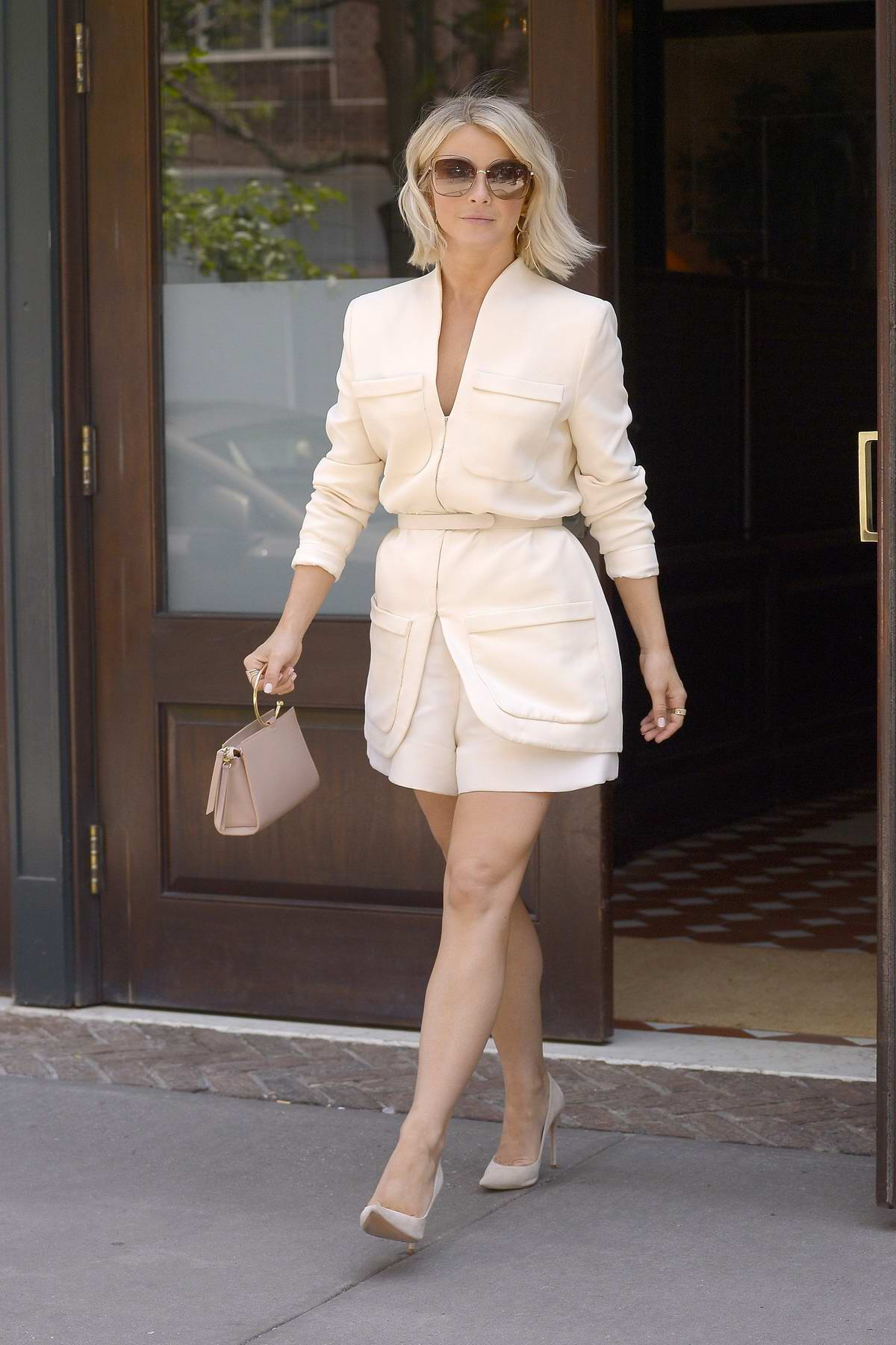 Julianne Hough looks classy in a beige blazer with matching shorts as she leaves her hotel in New York City