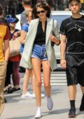 Kaia Gerber shows off her long legs while out with friends in New York City