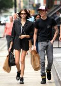 Kaia Gerber wears a pinstriped blazer and shorts while out shopping with her brother Presley Gerber in New York City