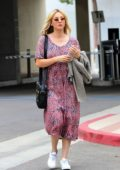 Kaley Cuoco looks pretty in pink floral dress while stopping by a studio in Los Angeles