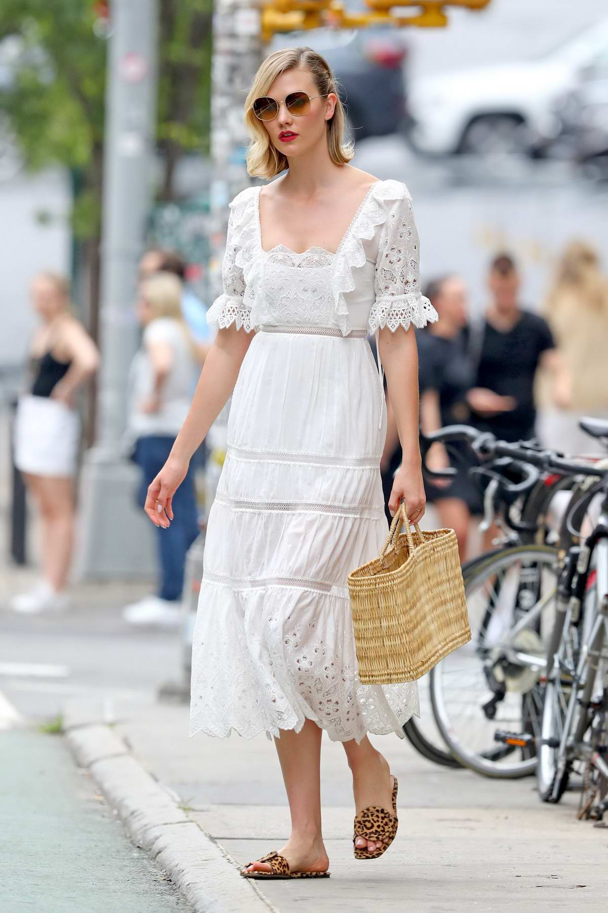 Karlie Kloss looks stunning in a 'Self Portrait' white summer lace dress while out in New York City