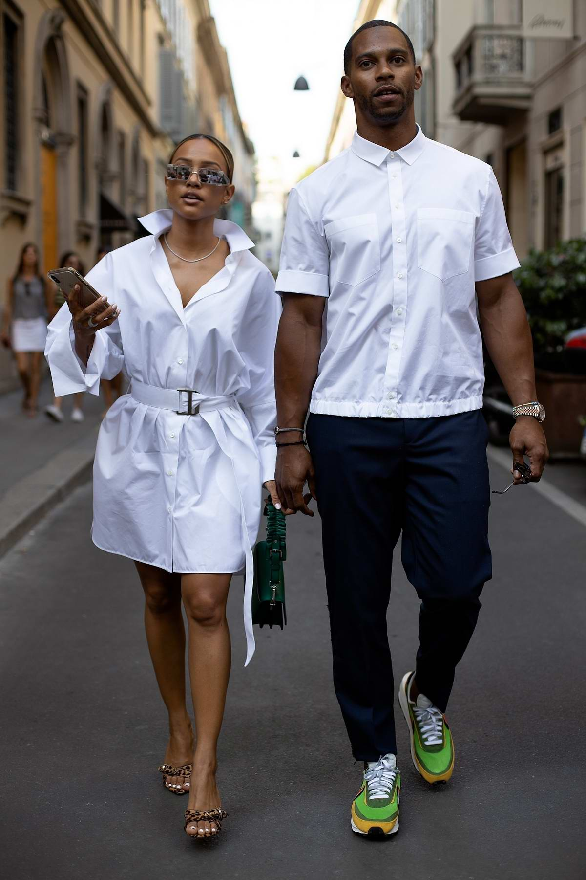 Karrueche Tran and Victor Cruz hold hands as they step out in matching outfits in Milan, Italy