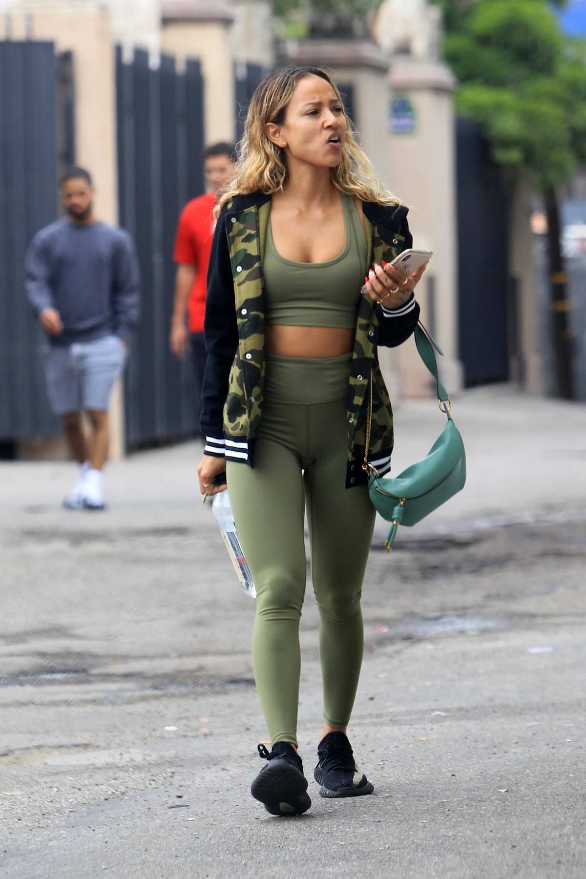 Karrueche Tran heads for a workout in all green athleisure in Beverly Hills, Los Angeles