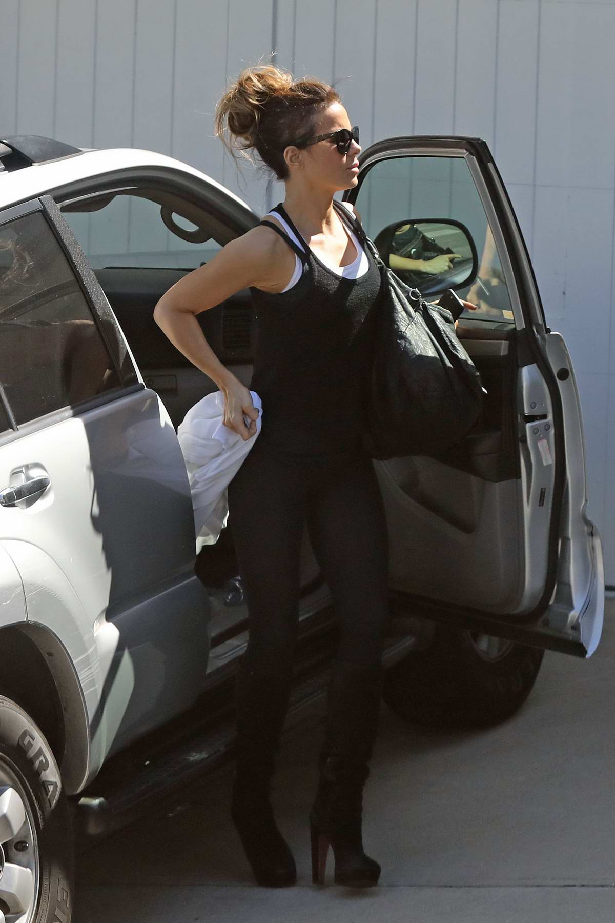 Kate Beckinsale rocks black tank top with matching leggings and knee high boots as she heads home from a gym in Los Angeles