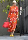 Katy Perry dons a form-fitting orange floral dress as she heads to dinner at Matsuhisa in Los Angeles