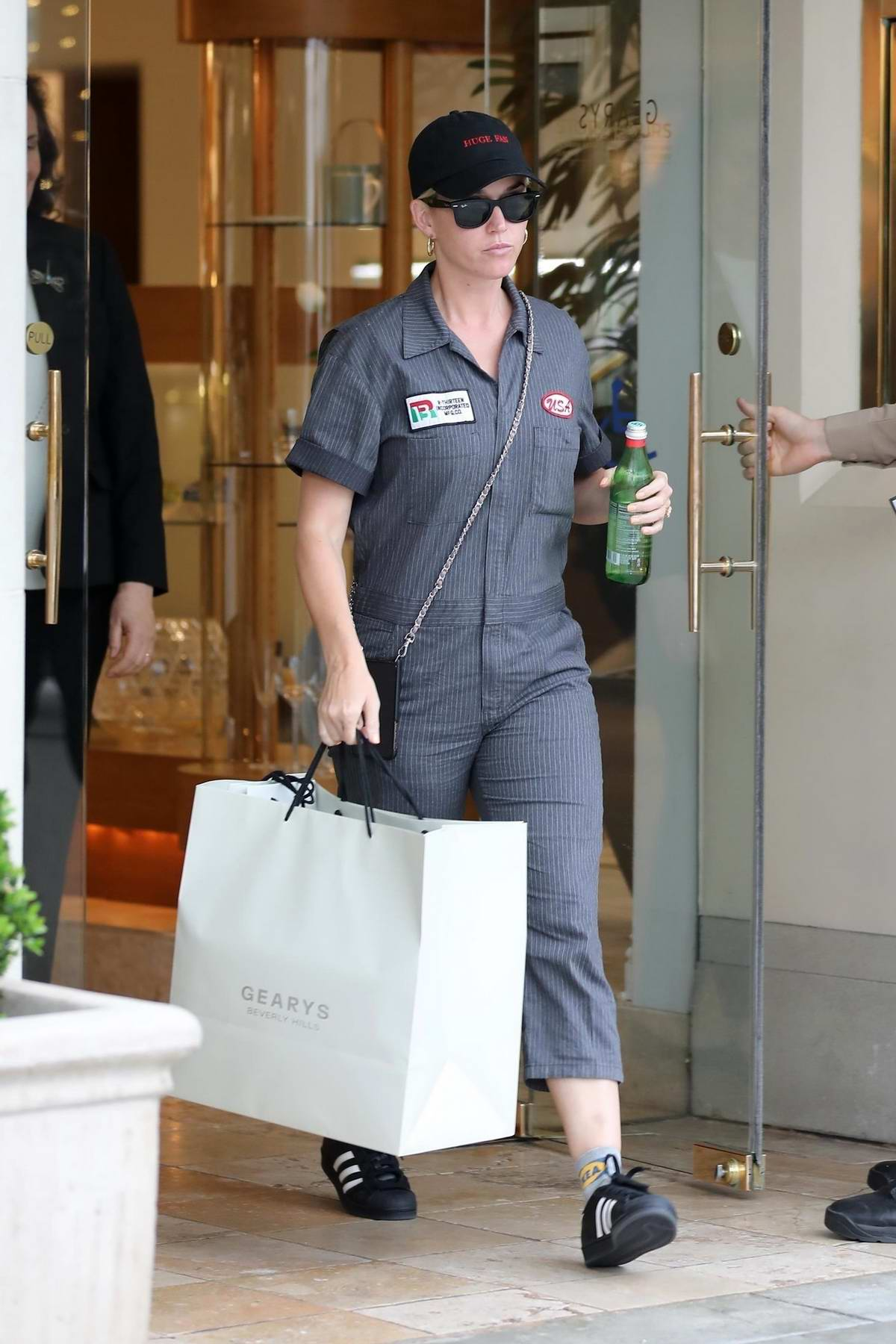 Katy Perry wears a grey jumpsuit while out shopping at Gearys in Bevely Hills, Los Angeles