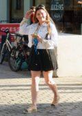 Kelly Brook dons white denim jacket, patterned shirt and a short black skirt as she leaves Global Radio Studios in London, UK