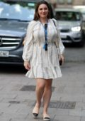 Kelly Brook looks lovely in a white summer dress as she arrives at Heart Radio Studios in London, UK
