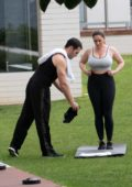 Kelly Brook spotted in a grey sports bra and black leggings during a workout session in Kent, UK