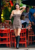 Kendall Jenner looks amazing in an animal print mini-dress and knee high boots during an outing with Luka Sabbat in New York City