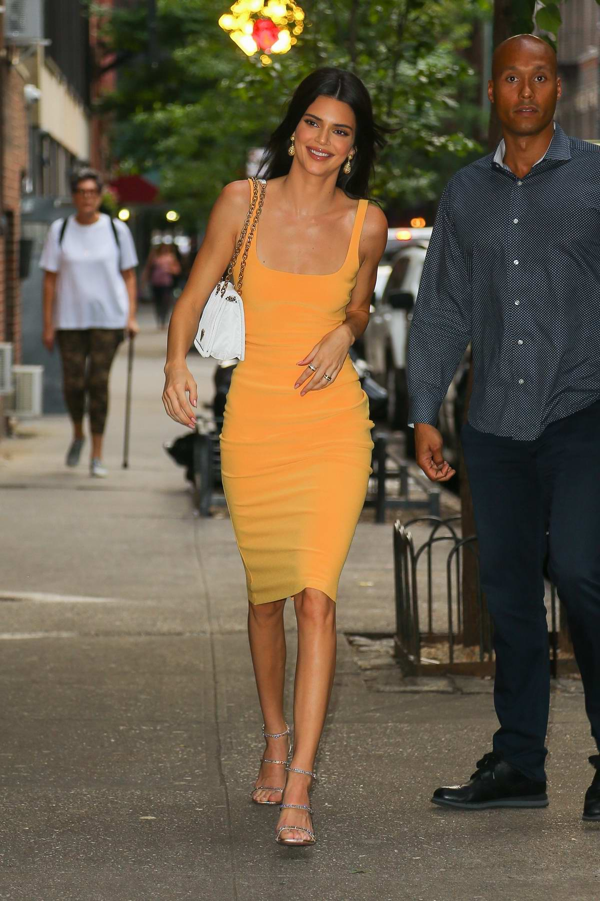 Kendall Jenner looks gorgeous in a yellow dress as she steps in New York City