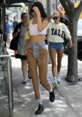 Kendall Jenner looks trendy in a cropped tank top and jeans as she heads to business meeting with Hailey Baldwin in Beverly Hills, Los Angeles