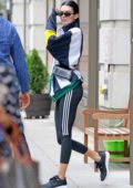 Kendall Jenner looks trendy in a windbreaker and black Adidas leggings as she leaves the gym in New York City