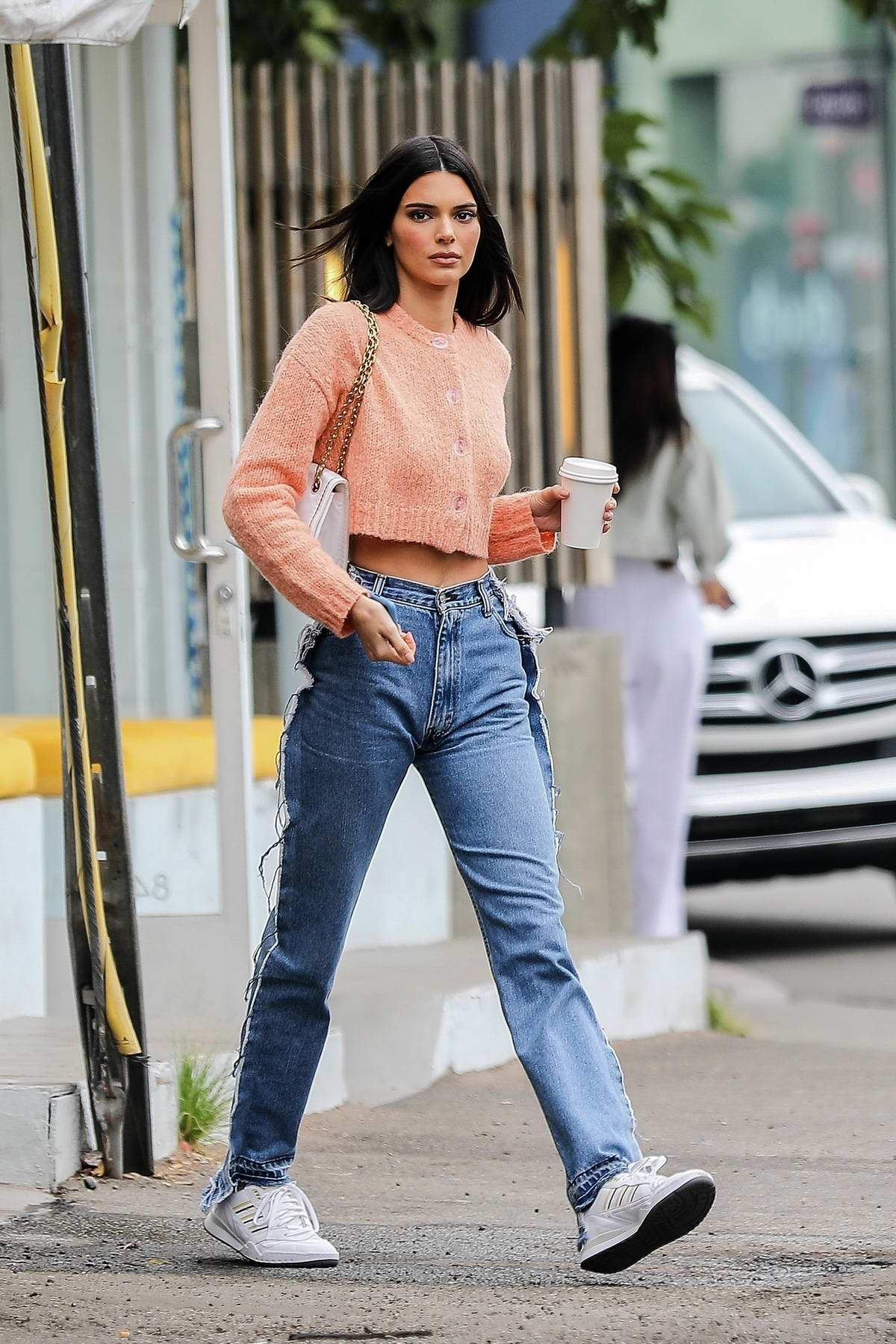 Kendall Jenner looks trendy in peach crop top and reversed jeans while out for coffee in West Hollywood, Los Angeles